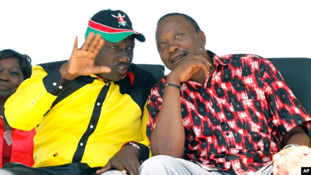 The National Alliance Party presidential candidate Deputy Prime Minister Uhuru Kenyatta right, and his running mate William Ruto, talk during a rally at Uhuru Park, in Nairobi, January 12, 2013.