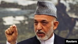 Afghan President Hamid Karzai speaks during a news conference in Kabul, June 12, 2012.