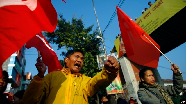Members of the splinter faction of the Unified Communist Party of Nepal Maoist shout slogans during a general strike called by the party against the decision to form an interim government in Katmandu, Nepal, February 19, 2013.