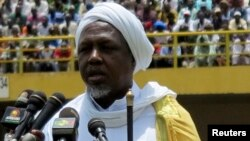 FILE - Mahmoud Dicko, the head of Mali's High Islamic Council, speaks during a rally at in Bamako, Aug. 12, 2012.