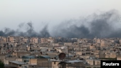 FILE - Smoke rises after airstrikes on the rebel-held al-Sakhour neighborhood of Aleppo, Syria, April 29, 2016.