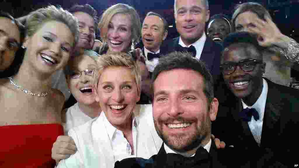"This image released by Ellen DeGeneres shows actors front row from left, Jared Leto, Jennifer Lawrence, Meryl Streep, Ellen DeGeneres, Bradley Cooper, Peter Nyong'o Jr., and, second row, from left, Channing Tatum, Julia Roberts, Kevin Spacey, Brad Pitt, Lupita Nyong'o and Angelina Jolie as they pose for a ""selfie"" portrait on a cell phone during the Oscars at the Dolby Theatre in Los Angeles, California, Mar. 2, 2014."