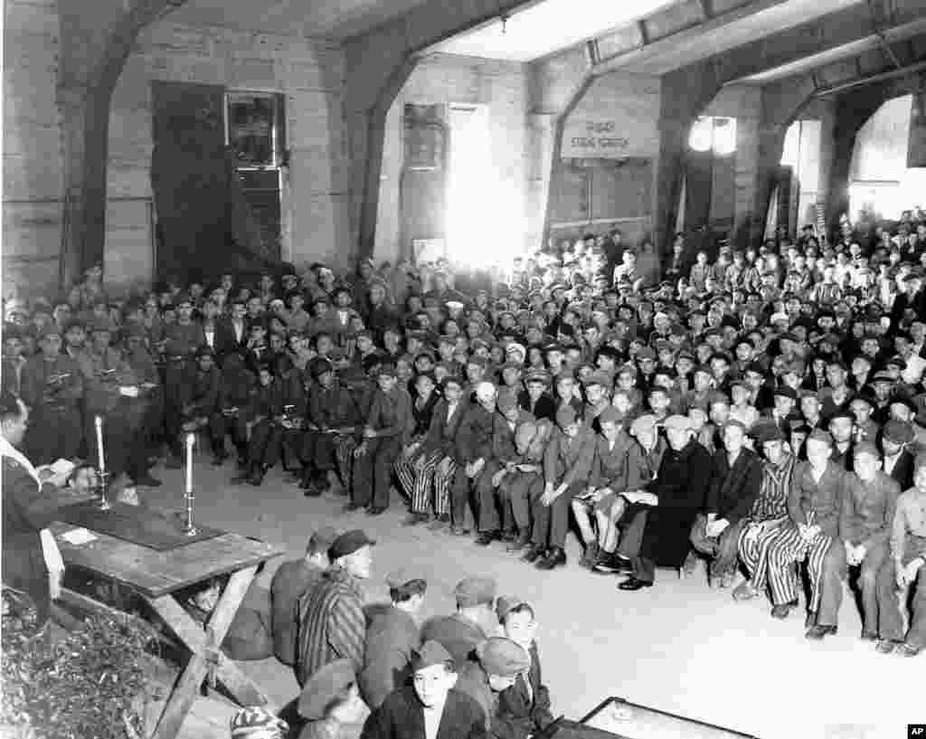 Chaplain Hershel Schacter conducts religious services at the liberated Buchenwald concentration camp in 1945. (Photo courtesy Jewish Chaplains Council)