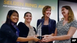 In this April 15, 2016 photo, reporters for the Associated Press Esther Htusan, Margie Mason, Robin McDowell and Martha Mendoza receive the Selden Ring Award for Investigative Reporting at USC Annenberg in Los Angeles. The team won the Pulitzer Prize for public service for articles documenting the use of slave labor in the commercial seafood industry in Indonesia and Thailand announced Monday, April 18, 2016. (AP Photo/Richard Vogel)