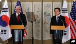 U.S. Vice President Mike Pence, left, speaks as South Korea's acting President and Prime Minister Hwang Kyo-ahn listens during a joint news conference after their meeting in Seoul, South Korea, April 17, 2017.