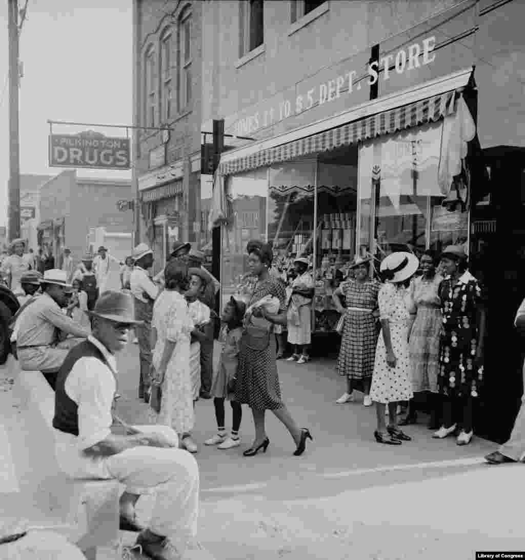 """Saturday Afternoon Shopping and Visiting on Main Street of Pittsboro North Carolina,"" by Dorothea Lange, 1939. (Photo credit: Prints & Photographs Division, Library of Congress)"