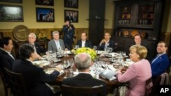 From the left: French President Francois Hollande, US President Barack Obama, British Prime Minister David Cameron, Russian Prime Minister Dmitry Medvedev, German Chancellor Angela Merkel, European Council president Herman van Rompuy, EU Commission presid