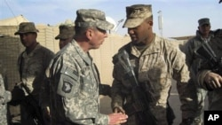 Gen. David Petraeus, left, top U.S. and NATO commander in Afghanistan, meets US marines during his visit to Marjah, Afghanistan, 25 Dec 2010