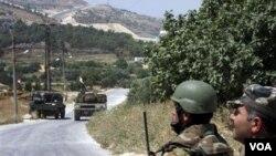 Pasukan Suriah mengepung kota Jisr-al-Shughour sebelum melakukan gempuran hebat (12/6).