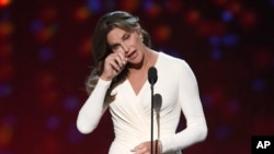 FILE - Caitlyn Jenner accepts the Arthur Ashe award for courage at the ESPY Awards at the Microsoft Theater in Los Angeles, July 15, 2015.