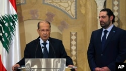Midest Lebanon Presidential Elections Saad Hariri, stands next of Christian leader Michel Aoun