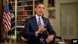 President Barack Obama tapes the weekly address, February 3, 2012