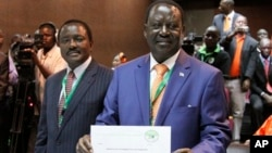 Orange Democratic Party presidential candidate, Raila Odinga (R), displays his registration certificate, with running mate Vice President Kalonzo Musyoka (L), in Nairobi, Kenya, January 30, 2013.