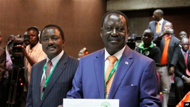Orange Democratic Party presidential candidate, Raila Odinga (R), displays his registration certificate, with running mate Vice President Kalonzo Musyoka (L), in Nairobi, Kenya, Jan. 30. 2013.