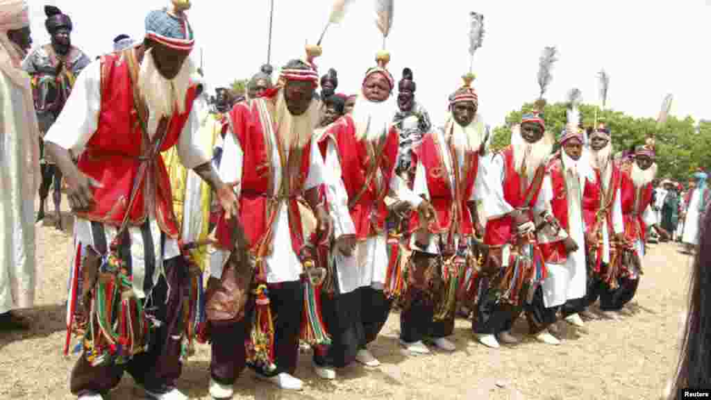 Traditional dancers take part in a parade as they pay homage to Emir of Kano Alhaji Ado Bayero during an event marking his 50th year on the throne.