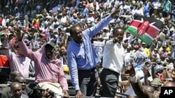 Kenya's former Education Minister William Ruto, center left, Kenya's Deputy Prime Minister Uhuru Kenyatta, center, and Kenya's Vice President Kalonzo Musyoka, center right, wave to thousands of people during a prayer rally at Uhuru Park, Kenya, April 11,