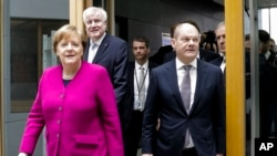 German Chancellor and Christian Democratic Union, CDU, party chairwoman Angela Merkel, left, Christian Social Union, CSU, party chairman Horst Seehofer, second from left, and Social Democratic Party, SPD temporary party leader Olaf Scholz, right, arrive for a news conference, in Berlin, Germany, Monday, March 12, 2018.
