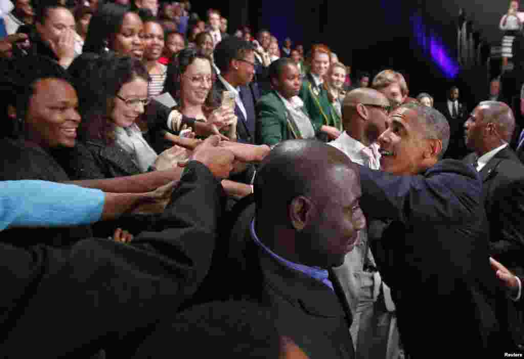 U.S. President Barack Obama greets participants at a town hall-style meeting with young African leaders at the University of Johannesburg in Soweto, June 29, 2013.