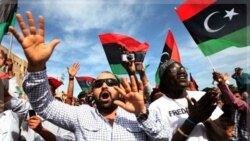Libyans celebrate at Martyrs Square in Tripoli on Thursday after hearing the news about Muammar Gaddafi