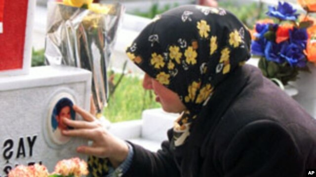 A Turkish girl cries while touching a picture of her brother on a decorated gravestone at a cemetery in Istanbul. The girl's brother was one of the Turkish soldiers who lost their lives in clashes against Kurdish rebels (File).