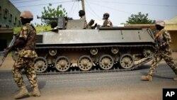FILE - Nigerian troops patrol in the northeastern Nigeria city of Mubi, 20 kilometers (14 miles) west of the Cameroon border, March 2015.