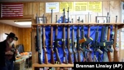 In this March 15, 2016 photo, guns for rent are on display at a shooting range and retail store in Cherry Creek, Colorado.