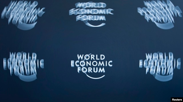 FILE - A logo, taken with long exposure, is shown at the World Economic Forum headquarters in Cologny near Geneva.
