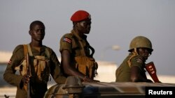 SPLA soldiers stand in a vehicle in Juba, December 20, 2013.