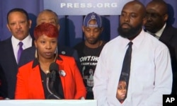 In this image from video the parents of Michael Brown, Lesley McSpadden, front left, and Michael Brown Sr., speak at a news conference with civil rights leaders at the National Press Club in Washington, Sept. 25, 2014.