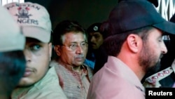 Pakistan's former president and head of the All Pakistan Muslim League (APML) political party Pervez Musharraf (C) is escorted by security officials as he leaves an anti-terrorism court in Islamabad, April 20, 2013.