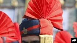A policeman attends a ceremony to mark India's Republic Day celebrations in Srinagar, January 26, 2011.