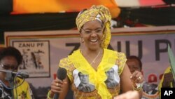 Zimbabwe's First Lady Grace Mugabe dances at a rally in Harare, Thursday, Nov. 19. 2015. (AP Photo/Tsvangirayi Mukwazhi)