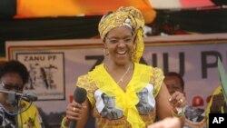 Zimbabwe's First Lady Grace Mugabe dances at a rally in Harare, Thursday, Nov. 19. 2015. (AP Photo/Tsvangirayi Mukwazhi)