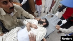 Rescue workers move a man, who was injured during an earthquake, at the Lady Reading hospital in Peshawar, Pakistan, Oct. 26, 2015.