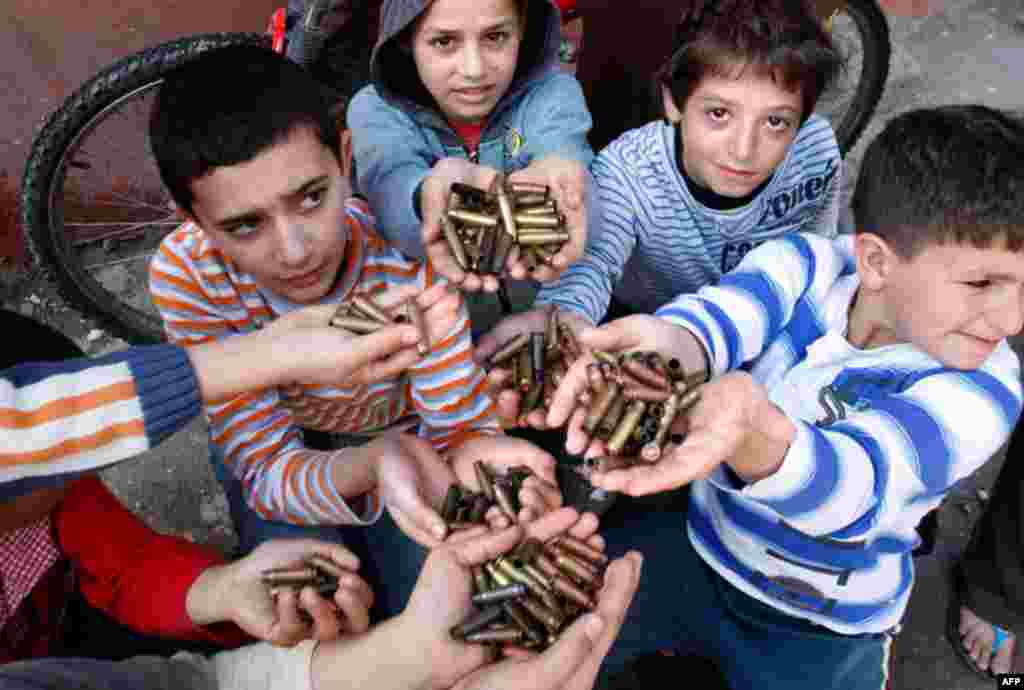 March 31: Palestinian children show bullet casings they gathered after clashes in the Palestinian refugee camp of Ein el-Hilweh near the southern port city of Sidon, Lebanon. (AP Photo/Mohammed Zaatari)