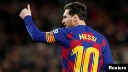 Dan wasan Barcelona Lionel Messi
