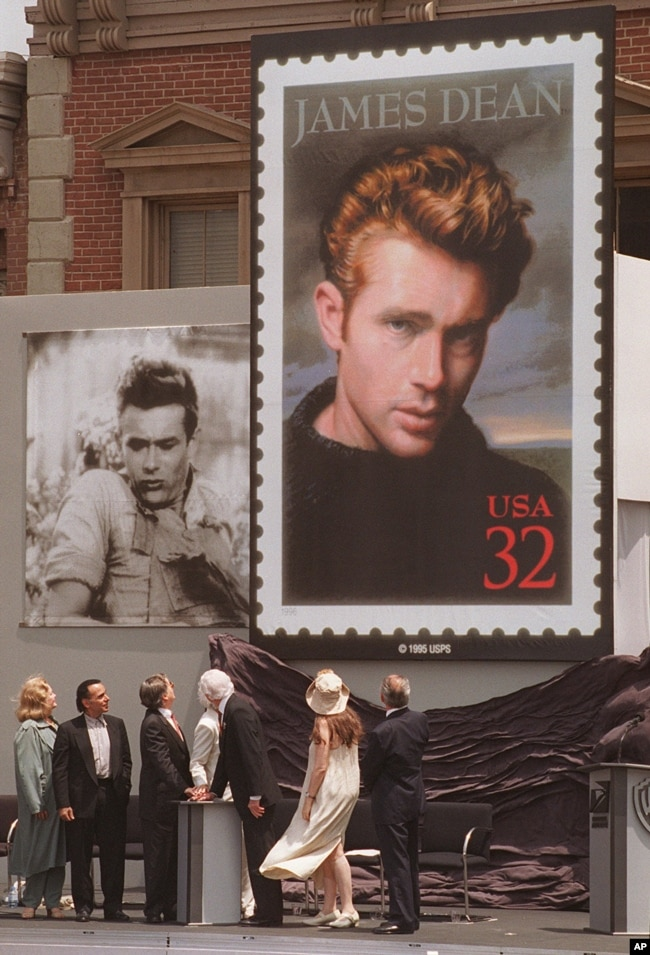 Postal and film industry officials view the unveiling of the new James Dean stamp at a ceremony, June 24, 1996 on the lot where Dean filmed