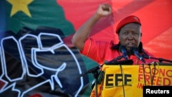 Julius Malema, leader of the Economic Freedom Fighters, gestures as he addresses supporters during the official launch of his political party in Marikana October 13, 2013.