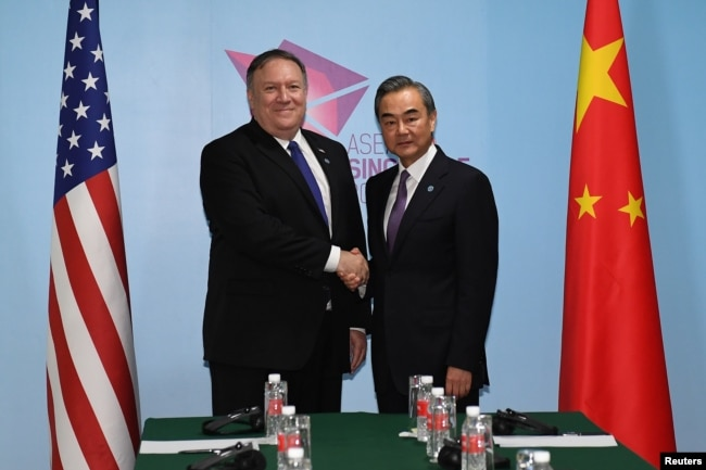 U.S. Secretary of State Mike Pompeo and China's Foreign Minister Wang Yi shake hands before their bilateral meeting at the 51st Association of Southeast Asian Nations (ASEAN) in Singapore, Aug. 3, 2018.