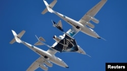 FILE - Virgin Galactic rocket plane, the WhiteKnightTwo carrier airplane, with SpaceShipTwo passenger craft takes off from Mojave Air and Space Port in Mojave, Calif., Feb. 22, 2019.