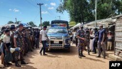 Law enforcement personnel arrive at Kitupalong Refugee camp in Ukhia on Sept. 30, 2021, a day after an unidentified assailant shot dead refugee leader Mohib Ullaha outside his office in a refugee camp.