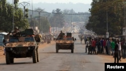 French peacekeeping soldiers advance in armored vehicles in Miskine district, a neighborhood that in the past few days experienced violent sectarian clashes, in the capital Bangui, Central African Republic, Jan. 30, 2014.