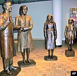 "Life-size sculptures of the four Obama family members comprise ""The Inauguration of Hope"""