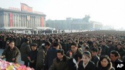North Koreans offer flowers to mark the birth anniversary of the North's late leader Kim Jong-Il at Kim Il-sung square in Pyongyang, in this photo taken by Kyodo, February 16, 2012.