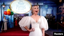 """Cast member Emily Blunt reacts on the red carpet at the world premiere of Disney's movie """"Mary Poppins Returns"""" in Los Angeles, California, Nov. 29, 2018."""