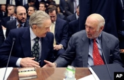 """Soros Fund Management chairman George Soros, left, shakes hands with Renaissance Technologies President James Simons on Capitol Hill in Washington, Thursday, Nov. 13, 2008, prior to testifying before the House Oversight and Government Reform Committee hearing on """"Hedge Funds and the Financial Market""""."""