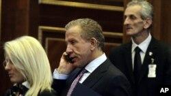 Newly chosen Kosovo president Behgjet Pacolli (center)
