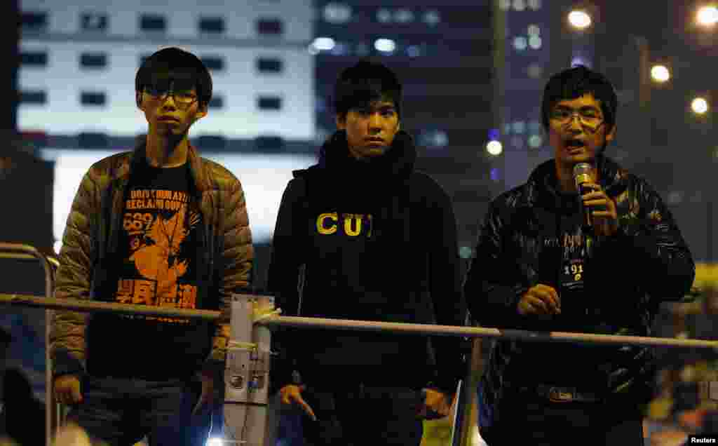 Student leaders Joshua Wong (left to right), Lester Shum and Alex Chow urge pro-democracy protesters to pack up their tents and leave the encampment at an Occupy Central rally outside the Legislative Council at Admiralty, in Hong Kong, Dec. 10, 2014.