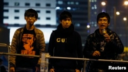 Student leaders Joshua Wong (L-R), Lester Shum and Alex Chow attend a rally at the Occupy Central protest site outside the Legislative Council at Admiralty in Hong Kong, Dec. 10, 2014.
