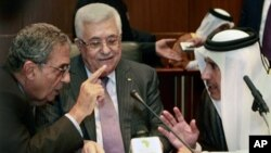 Palestinian President Mahmoud Abbas, center, listens to Qatar's Foreign Minister Sheik Hamad Bin Jassem, right, and Amr Moussa, secretary general of the Arab League, during the Arab Foreign Ministers Peace Initiative meeting, in Sirte, Libya, 8 Oct. 2010